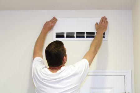 Man installing hepa filter