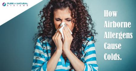 Airborne Allergens Causing a woman to sneeze from a cold